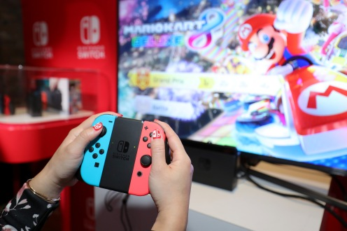 NEW YORK, NY - JANUARY 13: Nintendo of America, A guest enjoys playing Mario Kart 8 Deluxe on the groundbreaking new Nintendo Switch at a special preview event in New York on Jan. 13, 2017. Launching in March 3, 2017, Nintendo Switch combines the power of a home console with the mobility of a handheld. It's a new era in gaming that delivers entirely new ways to play wherever and whenever people want. (Photo by Neilson Barnard/Getty Images for Nintendo of America)